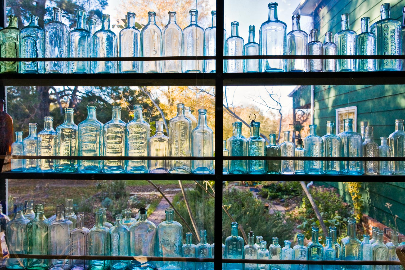 Old glass bottles in a window