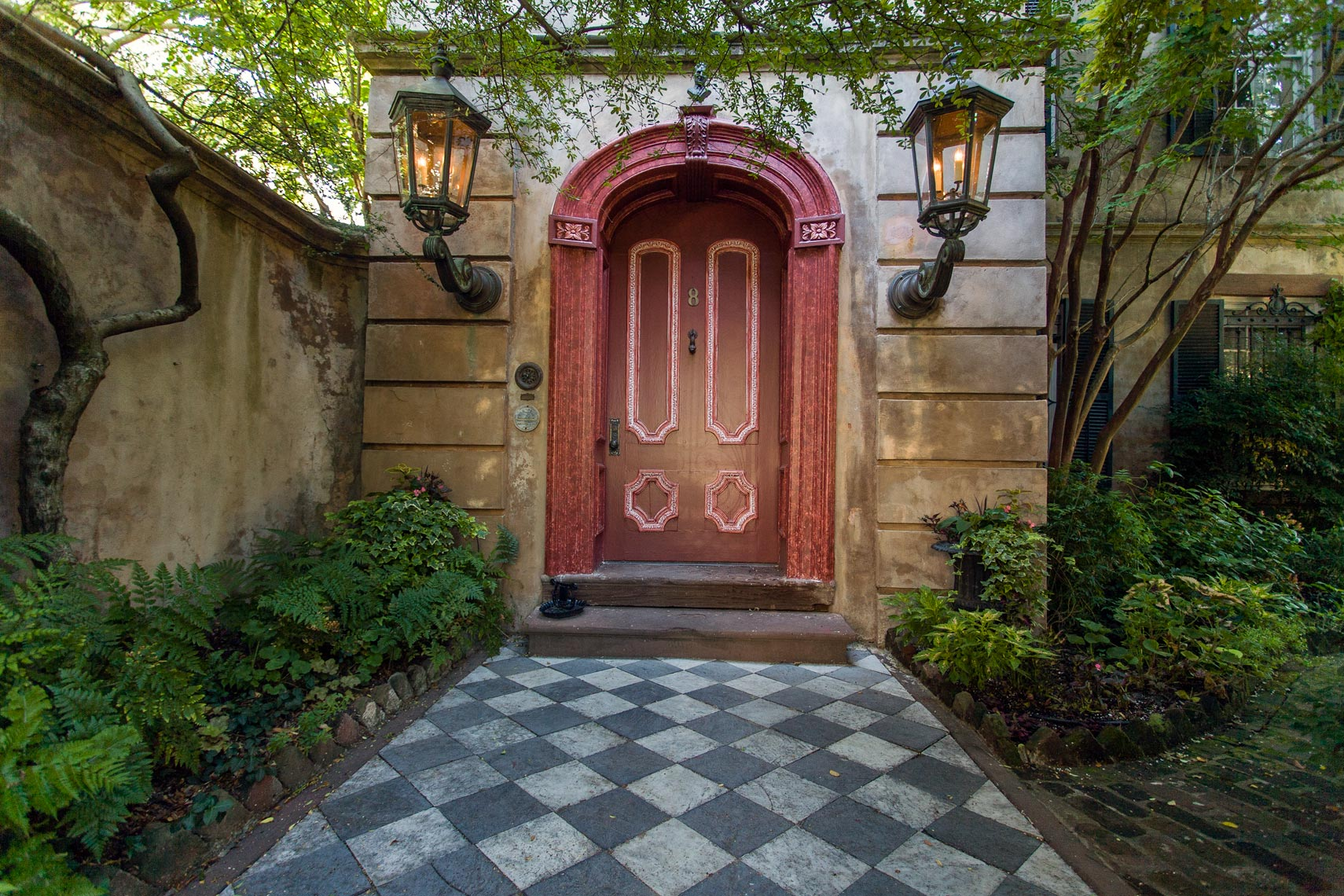 Tiled walkway and red door,Charleston, South Carolina