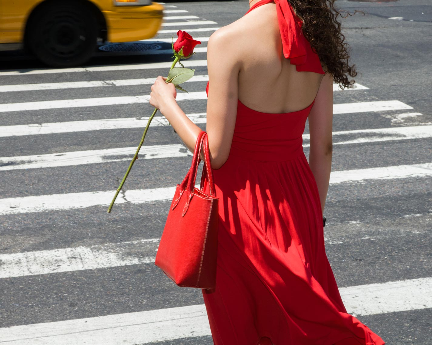 Woman in red with rose